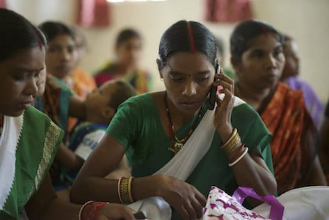 A young woman in India speaks on a mobile phone.