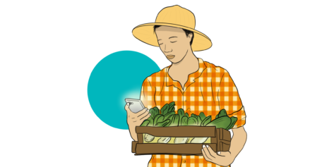 Farmer looking at mobile device